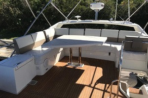 55' Prestige 550 2015 Flybridge Table Covered