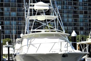 A MODO MIO is a Cabo 40 Express SF Yacht For Sale in North Palm Beach-Dockside Bow-2
