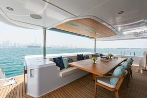 MAJESTY 120 is a Majesty Yachts Raised Pilothouse Yacht For Sale-Aft Deck-2