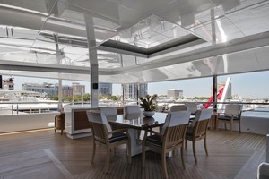 Skylounge Aft Deck - Dining Table Expands to Dine up to 12 Guests