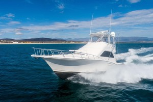 Satisfaction is a Cabo 48 Yacht For Sale in Cabo San Lucas-Port Side Running-2