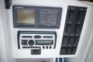 68' Hatteras 68GT 2009 Electronics Console Cabinet- Switches, Stereo, Furuno