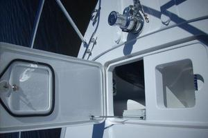 68' Hatteras 68gt 2009 Bow Deck Custom Storage and Livewell Open