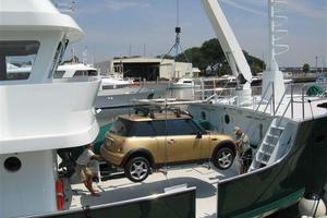 95' Explorer Expedition Yacht 2005 Mini Cooper being lifted on board
