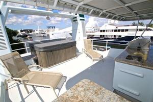 95' Explorer Expedition Yacht 2005 Flybridge aft showing hot tub