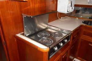 42' Carver 4207 1988 1988 Carver 4207 Aft Cabin Motor Yacht galley stove & counter