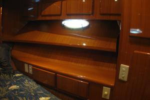 52' Symbol 50 2002 Some of the built in storage in the center master suite