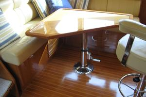 52' Symbol 50 2002 Dining table behind the captain in the pilothouse