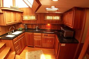 52' Legacy Yachts Flybridge Sedan 2004 Well-appointed Galley with black granite counter