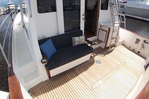 52' Legacy Yachts Flybridge Sedan 2004 Cockpit to starboard; step to Side Decks; Cushioned Bench Seat