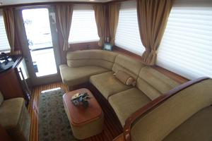 52' Legacy Yachts Flybridge Sedan 2004 Salon to aft/port; couch with matching ottoman