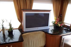 52' Legacy Yachts Flybridge Sedan 2004 TV with remote electronic lift; conceals in black granite counter