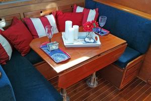 40' Bristol 40 sloop 1972 U-shaped dining area. Dining table has fold-down leaves.
