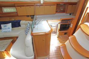 45' Jeanneau Sun Odyssey 45 Shoal Draft 2007 Full Galley To Starboard W/Double Stainless Sink, Refrigerator/Freezer, And Stainless Propane Stovetop & Oven