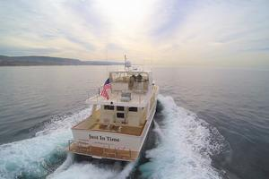 64' Offshore 64' Voyager 2010 Stern at speed