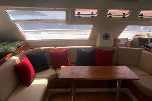 47' Leopard 47 PC 2008 Salon with custom teak table