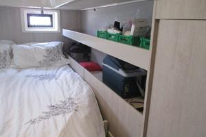 48' Leopard 48 2015 Owner's berth / shelving