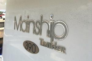 39' Mainship 390 Trawler 2000 insignia