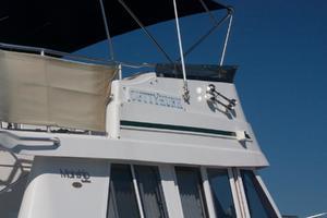 39' Mainship 390 Trawler 2000 Name on Flybridge