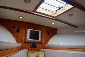 Custom-Middleton-Sports-Fisherman-2008-Chasing-Tail-Dania-Florida-United-States-Fore-Cabin-Detail-with-TV-and-Hatch-to-Bow-913252