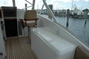 45' Gillikin Custom Carolina 45 Express 2009 Helm Deck Freezers and Release Marine Teak Mate's Chair