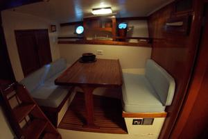 57' Trumpy CPMY 1960 Dinette on Portside opposite Galley